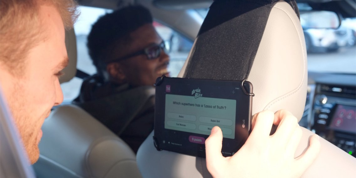Passenger engaging with Octopus tablet in car